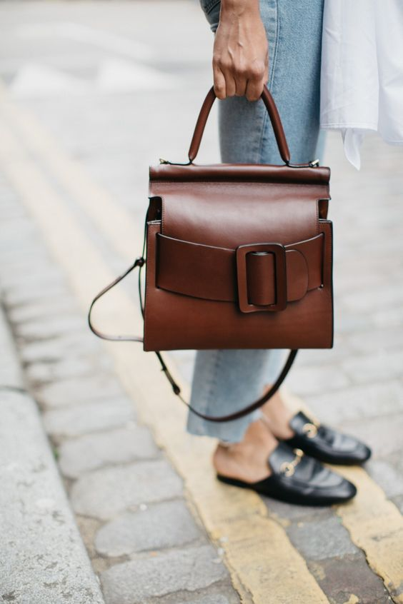 a gorgeous warm brown leather bag with an oversized buckle and strap plus handles