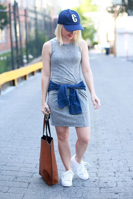 With gray dress, white sneakers, brown tote and blue sweatshirt