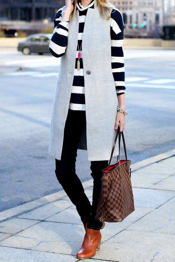 a striped long sleeve, black skinnies, amber boots, a dove grey long vest for a casual look