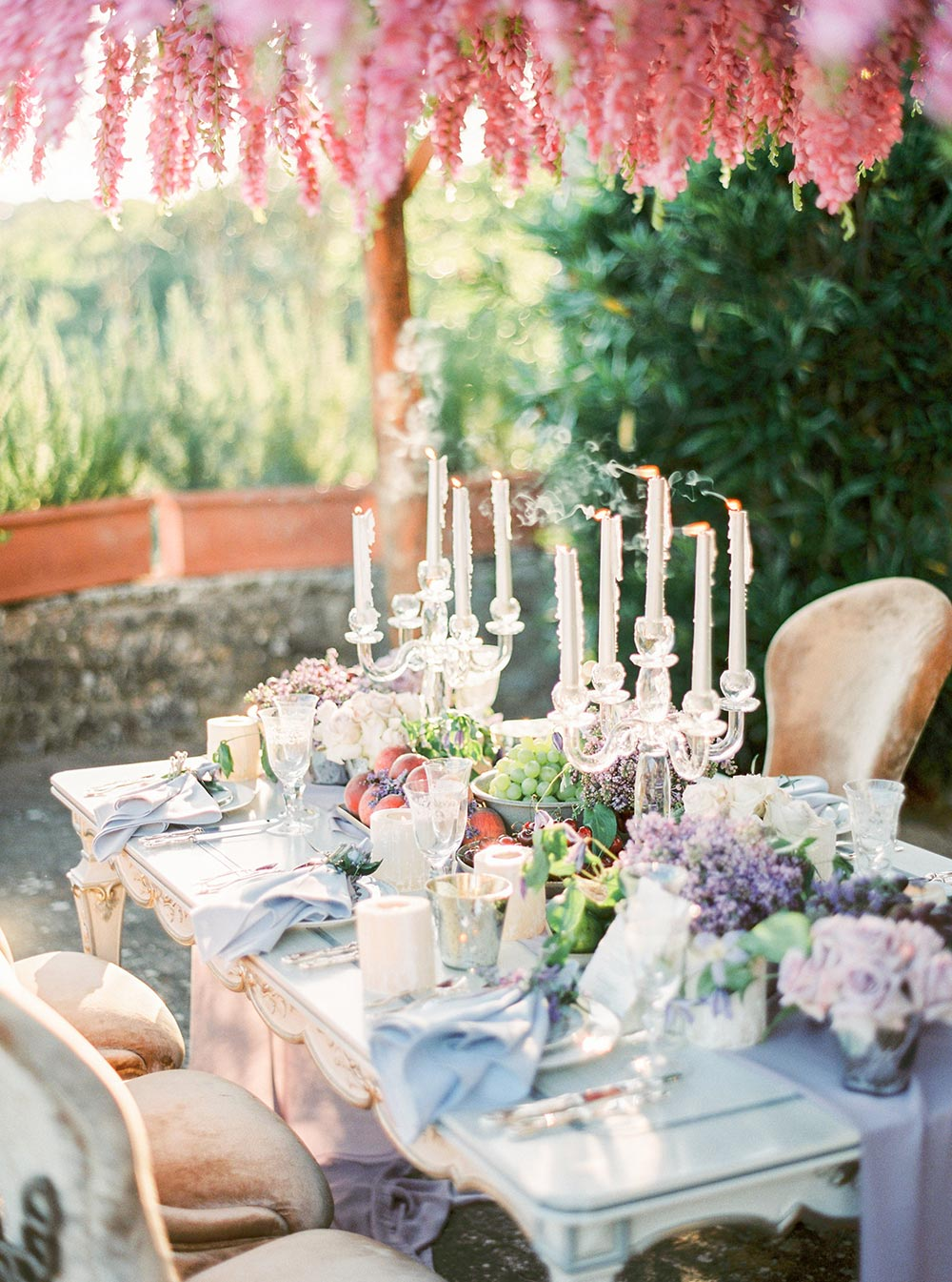 romantic outdoor wedding tablescape blue and purple wedding flowers