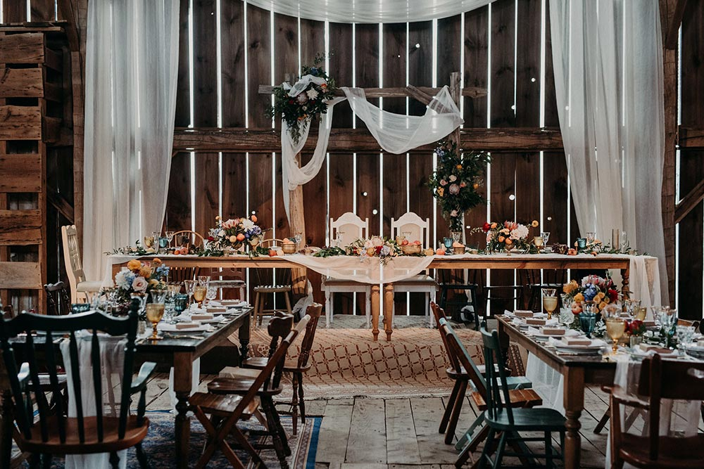 eclectic barn wedding reception tablescape