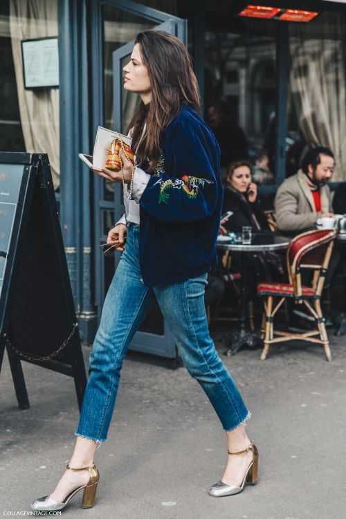 blue raw edge jeans, metallic shoes and a navy embroidered bomber jacket