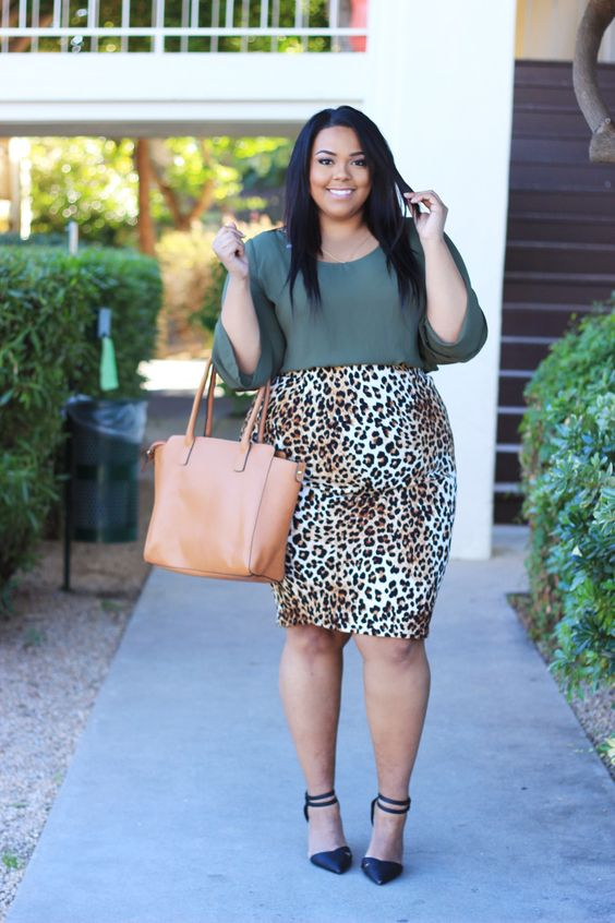 an army green top with long sleeves, a leopard print knee skirt, black shoes and a tan bag