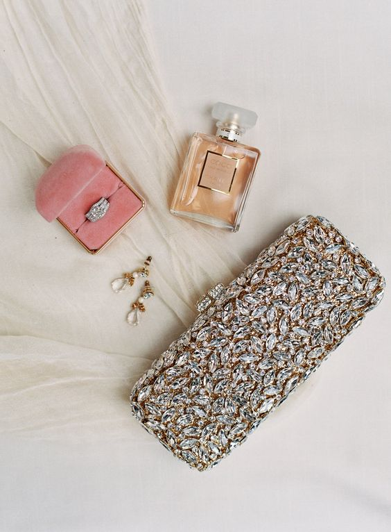 a glam fully embellished wedding clutch will add a glam touch to the bridal look