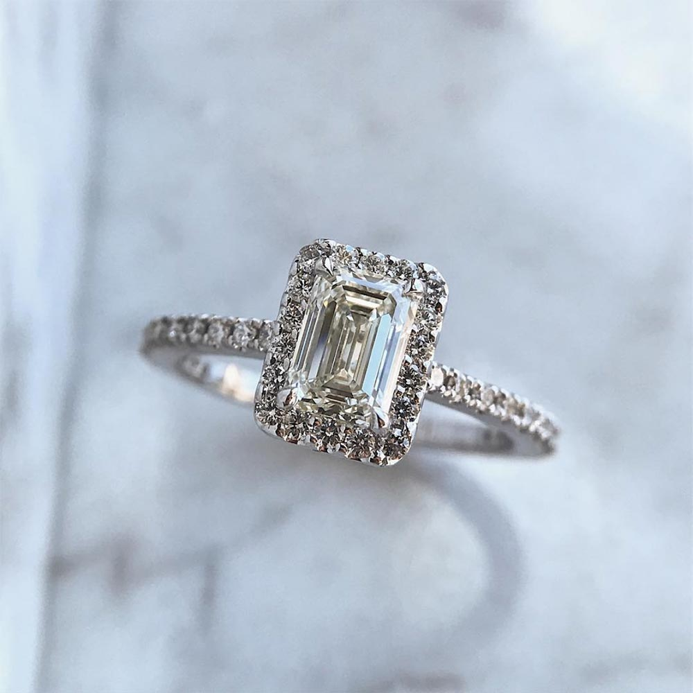 classic emerald cut engagement ring with diamond halo