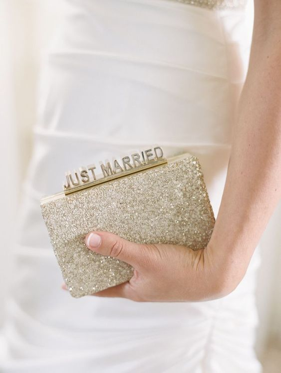 a sparkly gold sequin clutch with JUST MARRIED touch for a fun look