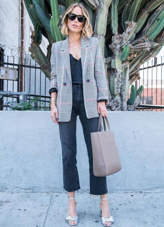 a black lace top, black cropped jeans, a grey plaid blazer, silver shoes and a neutral bag