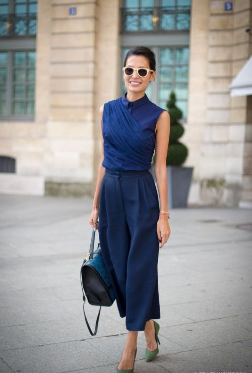 navy culottes, a navy wrap sleeveless top, green shoes and a blue bag for a chic look
