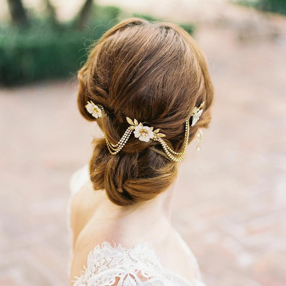 low wedding bun with adornments
