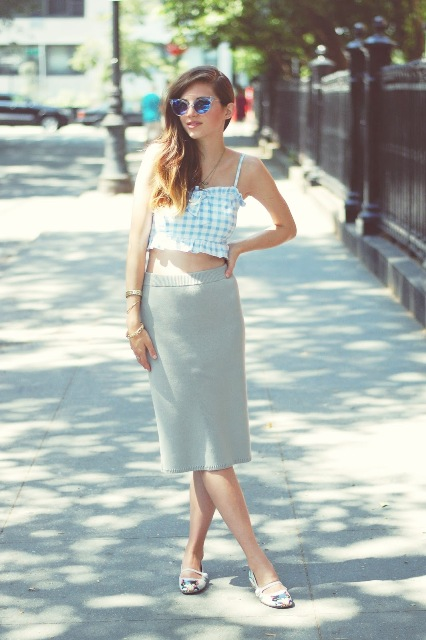 With gray midi skirt, flats and sunglasses