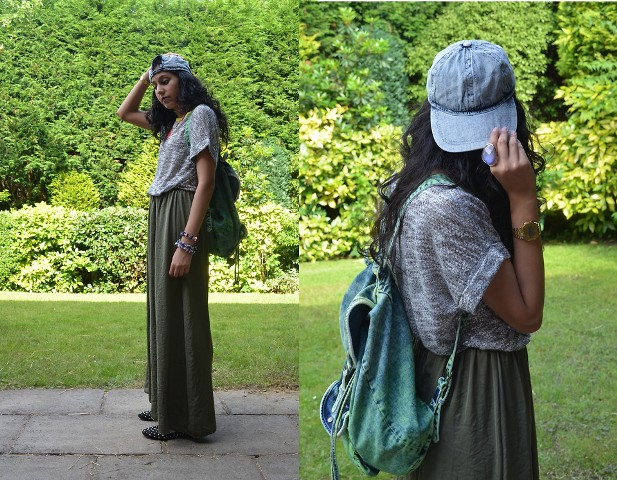 With gray loose shirt, maxi skirt and backpack