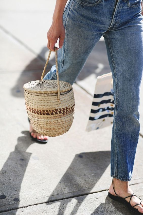 a barrel-shaped straw bag to accent a casual outfit and make it even more relaxed