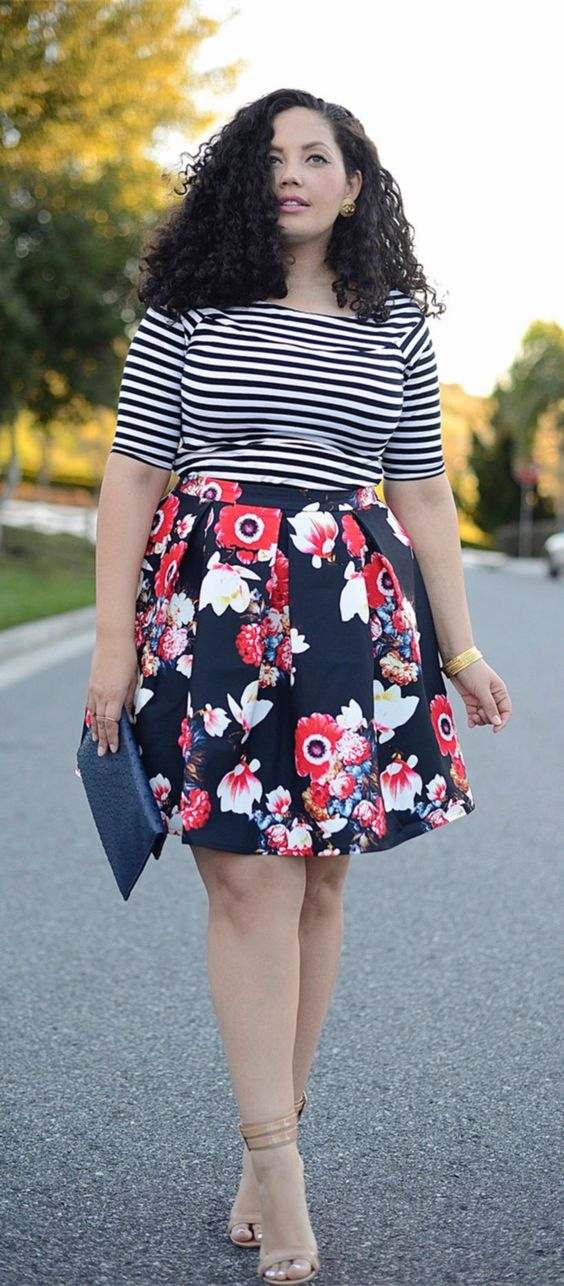 mixing prints right with a striped top, a floral full skirt, nude shoes and a navy clutch