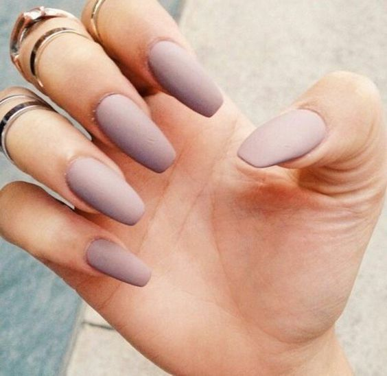 a very soft lavender shade on long nails may be a great idea for a romantic girl