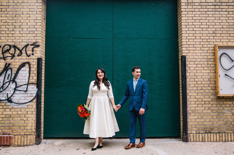 The groom was wearing a bold blue suit, a light blue tie and brown shoes