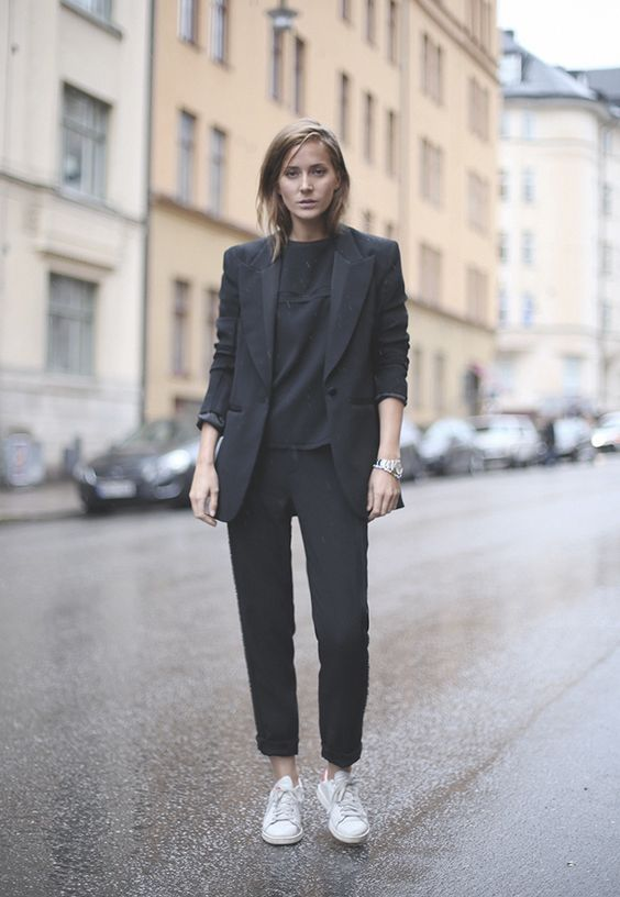 a black pantsuit, a black tee and white sneakers to wear right now