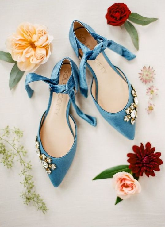 blue pointed flats with ties and embellishements for a bold and catchy look