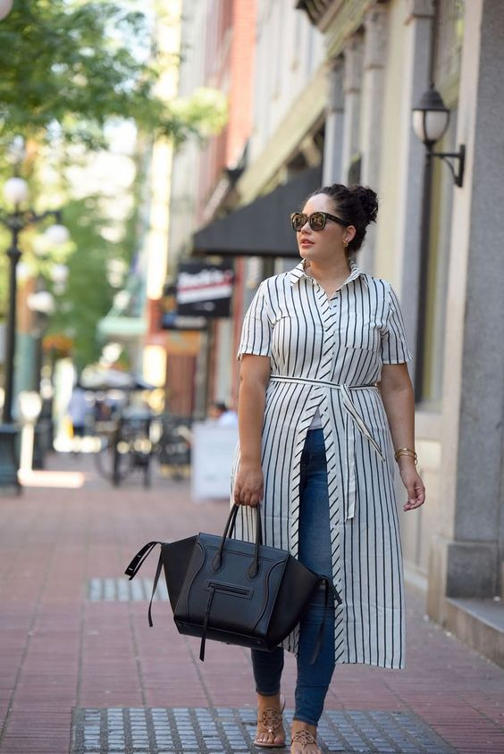blue skinnies, a striped shirtdress, sandals and a large black tote for a casual look
