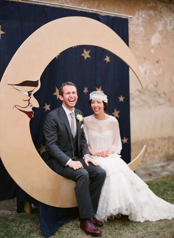 a vintage crescent moon wedding photo booth backdrop, a curtain to imitate a night sky with stars