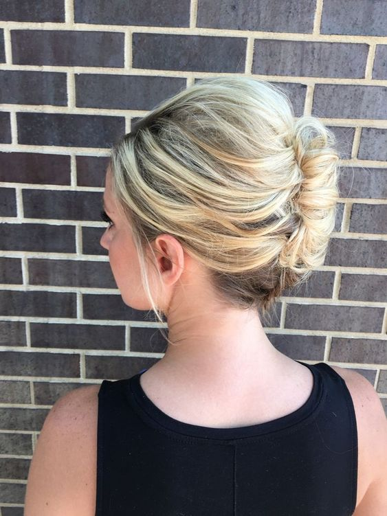 a sophisticated sleek French twist updo is perfect for work