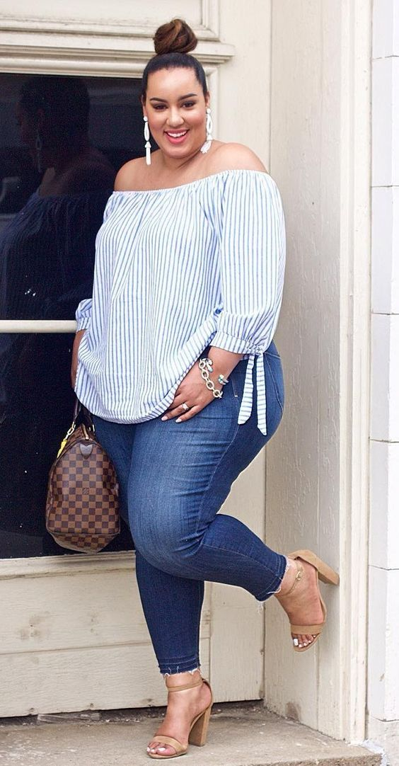 blue skinnies, nude heels, a blue and white striped off the shoulder top and statement earrings