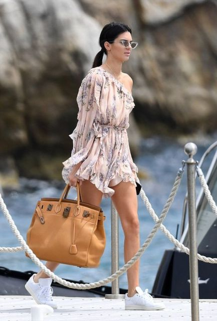 With white sneakers, brown leather tote and sunglasses