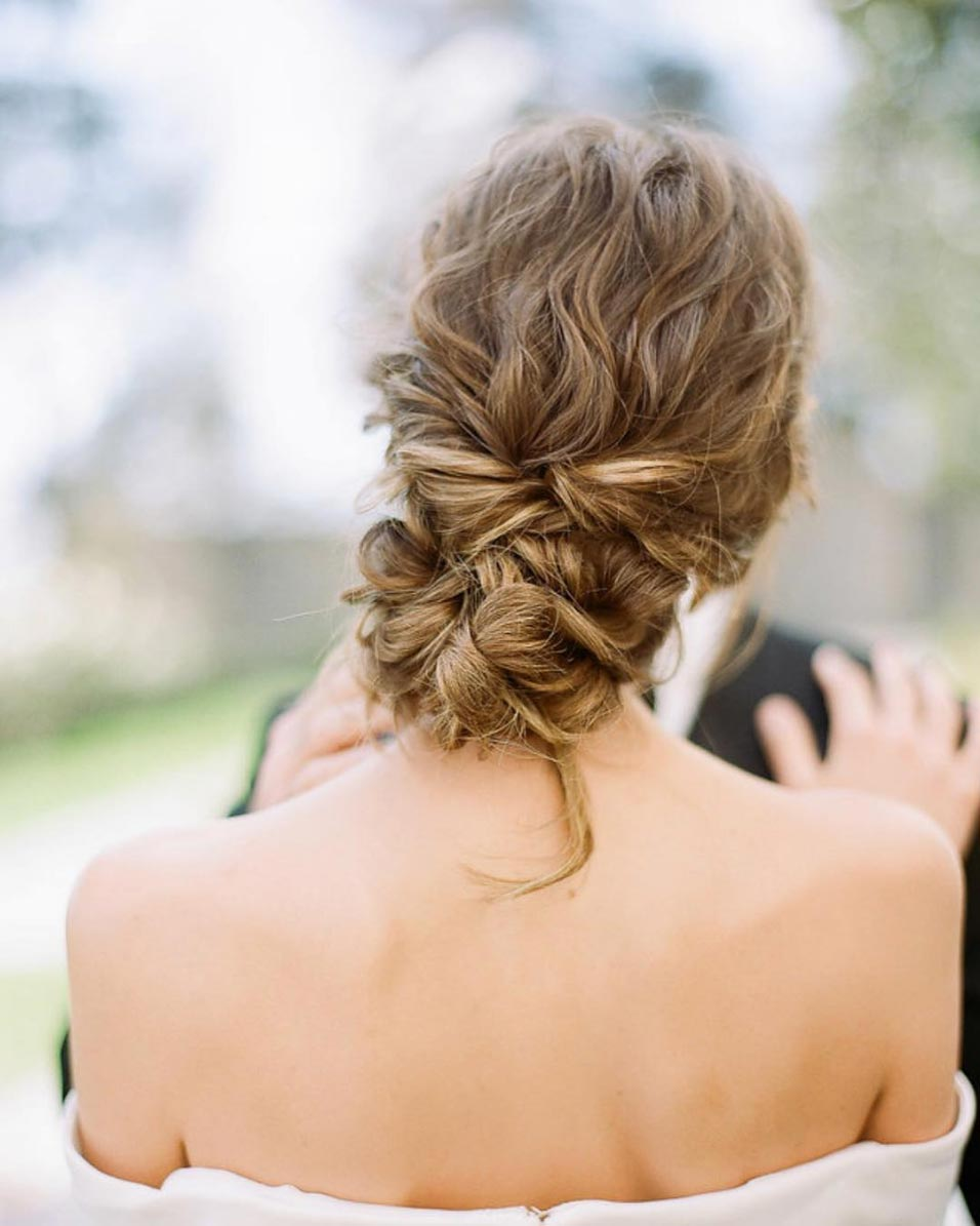 curly hair loose bridal updo