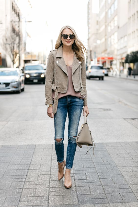 blue ripped skinnies, a mauve top, a grey suede moto jacket and a matching bag, nude heels