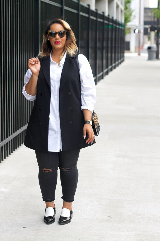 black ripped skinnies, a long white shirt, a black vest and black flats for a monochrome look