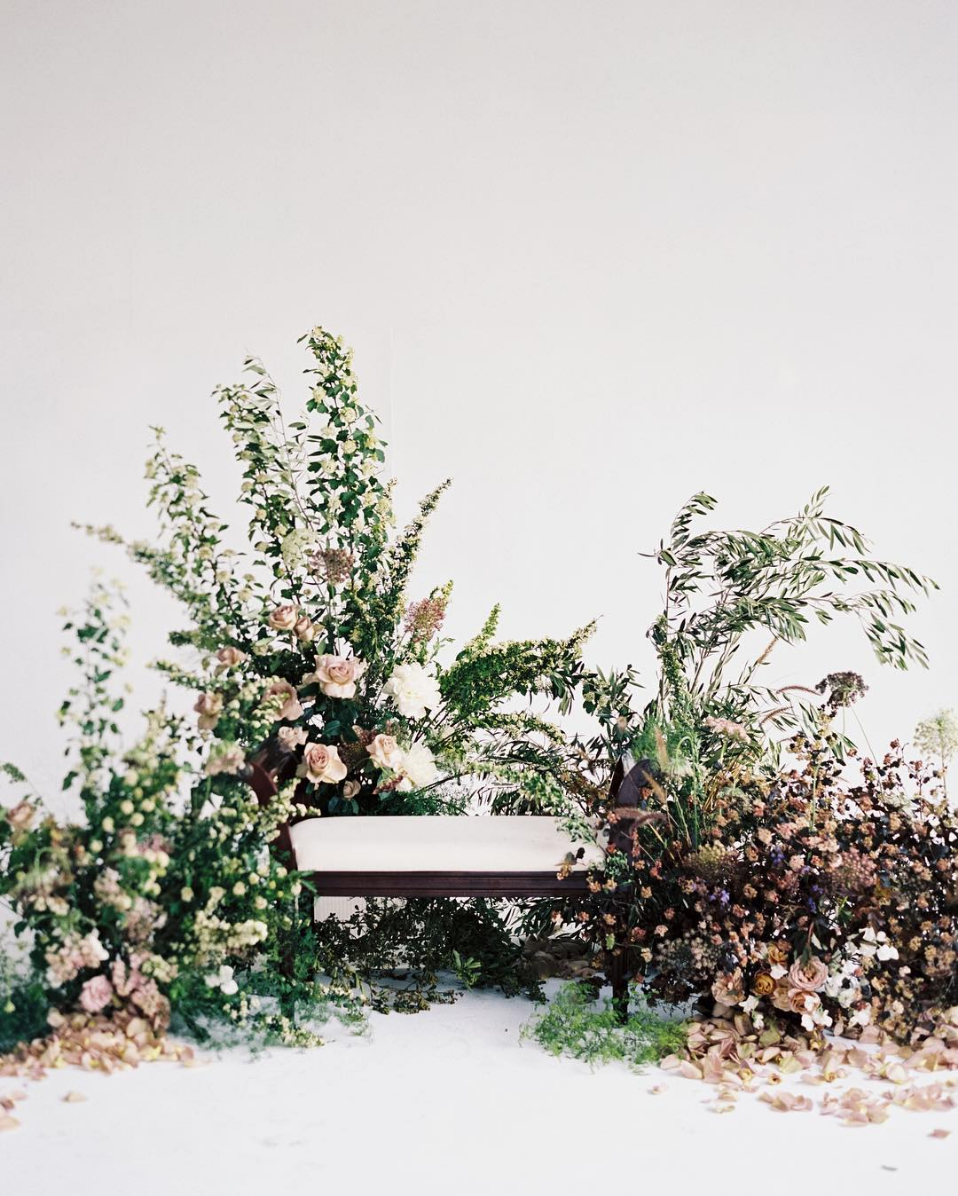 unstructured ceremony backdrop wedding flowers