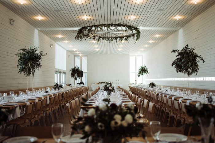 The wedding venue was a white and serene one, done with greenry touches - centerpieces and chandeliers