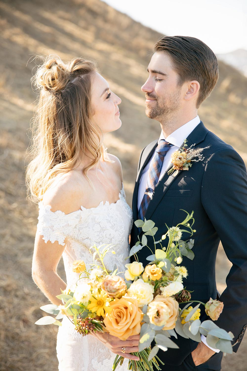 off-the-shoulder lace wedding dress and boho bridal hairstyle half up half down