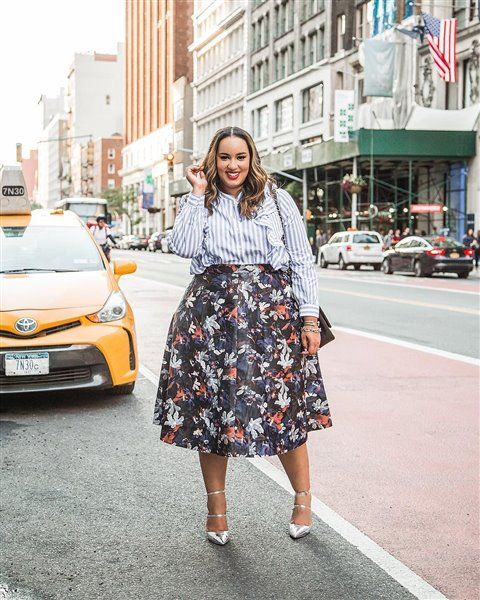 a striped shirt with ruffles, a full floral midi skirt, silver strappy heels