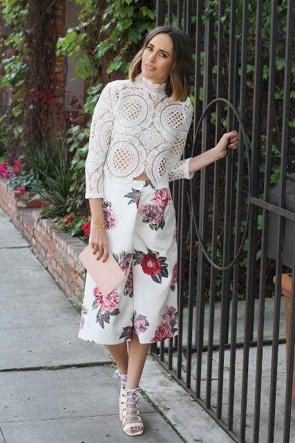 With white lace shirt, pale pink clutch and white shoes