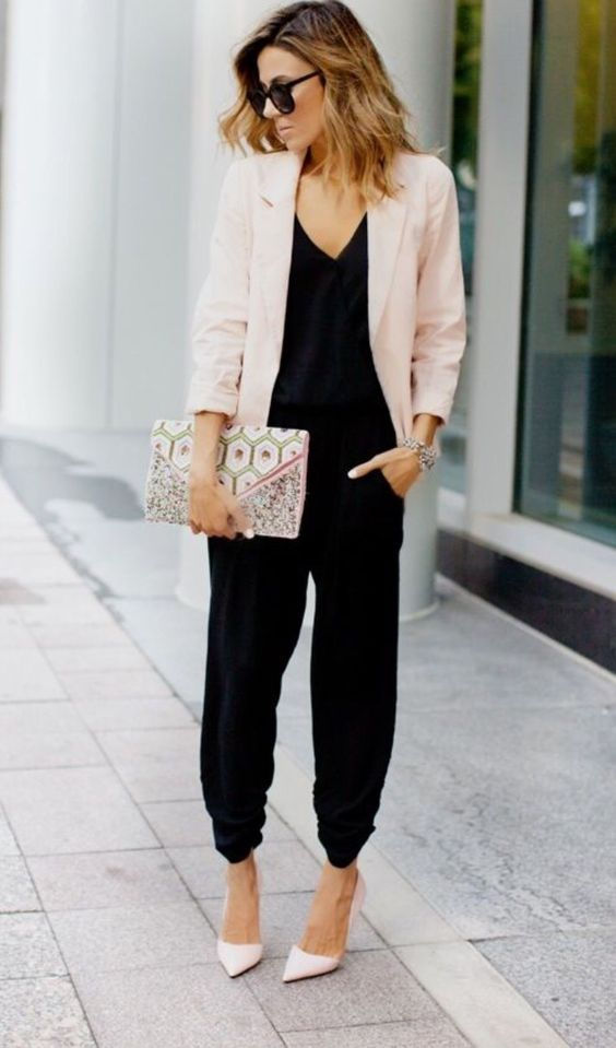 a black jumpsuit, a blush blazer, blush shoes and a printed clutch for a chic contrasting look