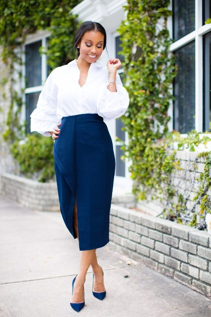 With blue midi skirt and blue pumps