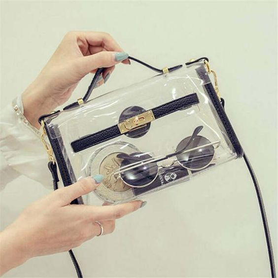 a gorgeous clear crossbody bag with black leather and gold detailing