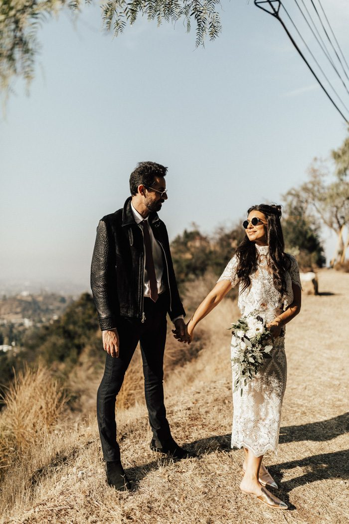 The couple rocked rock-n-roll styled glasses and the groom added a leather jacket