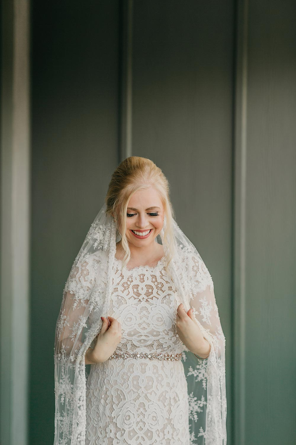 cap-sleeve lace wedding dress and veil