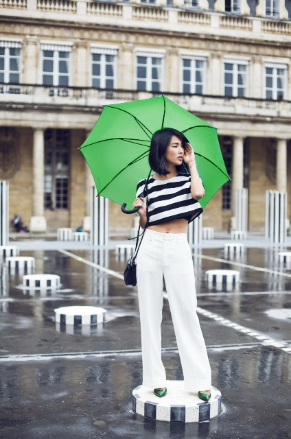 With white wide leg pants and green pumps