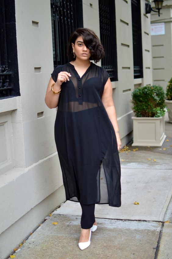black pants, a black top plus a sheer black shirtdress, white shoes