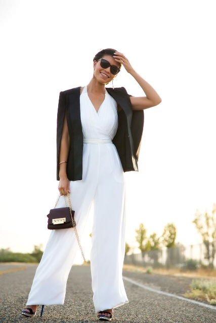With high heels, black blazer and chain strap bag