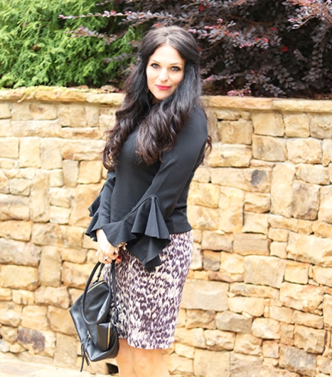 With printed skirt and black bag