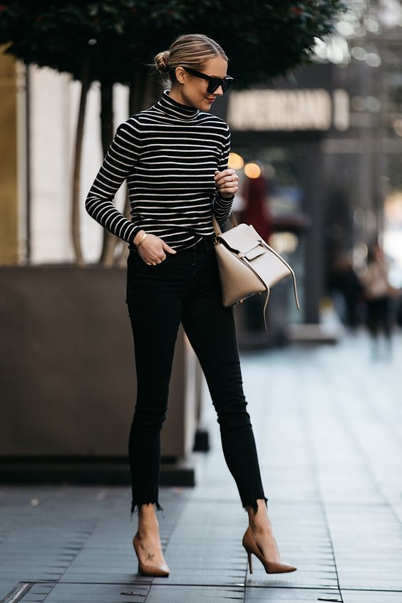 nude pumps and a neutral bag, black raw edge jeans and a black and white striped top