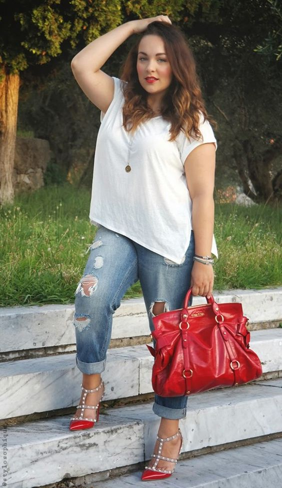a white tee, ripped blue boyfriend jeans, red spiked heels and a red bag