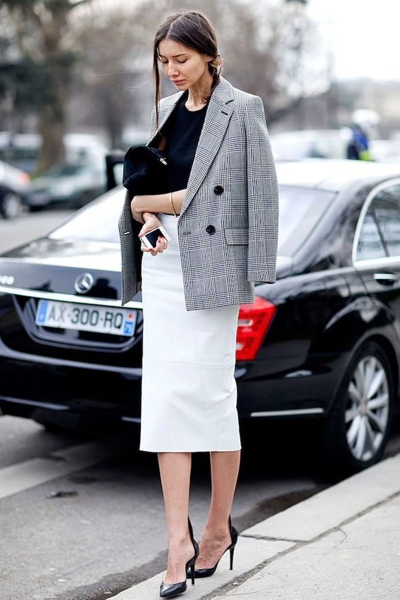 a black top, a creamy midi pencil skirt, black shoes and a grey plaid blazer for a work outfit