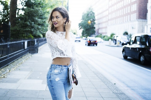 With distressed jeans