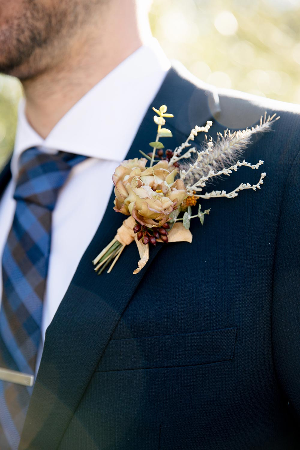 dried yellow flower boutonniere