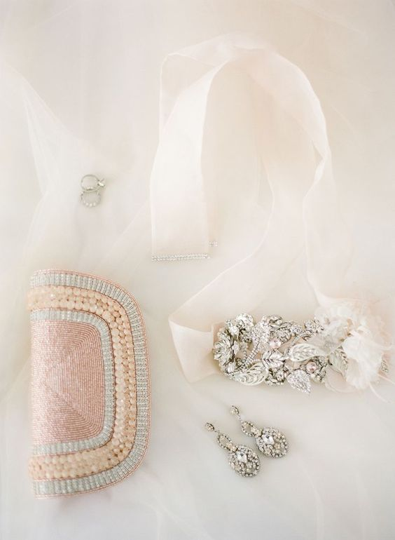 a blush beaded and pearled clutch to add a colorful touch to the bridal look
