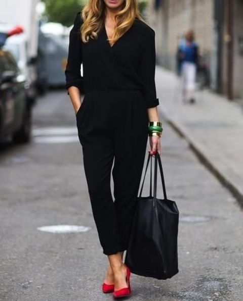 a black casual jumpsuit with long sleeves, red shoes and a comfy bag is a stylish idea for work